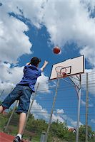 Boy Playing Basketball Stock Photo - Premium Royalty-Freenull, Code: 600-03799508