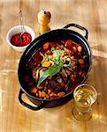 Adding the white wine and the tomato coulis to the beef and carrot stew Stock Photo - Premium Royalty-Free, Artist: Yvonne Duivenvoorden     , Code: 652-03801209