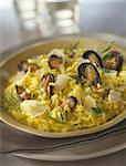 Saffron risotto with mussels and parmesan Stock Photo - Premium Royalty-Free, Artist: Photocuisine, Code: 652-03801953