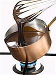 Whipping melted dark chocolate in a copper saucepan Stock Photo - Premium Royalty-Free, Artist: Photocuisine, Code: 652-03802241