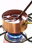 Stirring hot chocolate in a copper saucepan Stock Photo - Premium Royalty-Free, Artist: Photocuisine, Code: 652-03802251