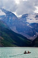 Canoeists on Lake Louise with Mounts Lefroy and Victoria, Banff National Park, Alberta, Canada Stock Photo - Premium Royalty-Freenull, Code: 600-03805333