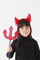 Girl Dressed In Halloween Costume as Devil Stock Photo - Premium Rights-Managednull, Code: 859-03806278