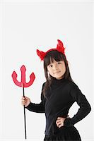 Girl Dressed In Halloween Costume as Devil Stock Photo - Premium Rights-Managednull, Code: 859-03806281