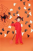 Boy Dressed Up As Devil against Orange Background Stock Photo - Premium Rights-Managednull, Code: 859-03806342