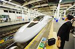Asia, Japan, Shinkansen Bullet Train, business man waiting for train Stock Photo - Premium Rights-Managed, Artist: AWL Images, Code: 862-03807638