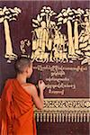 Young novice monk reading the description of a golden wall painting at Wat Jong Kham monastery, Keng Tung, Burma Stock Photo - Premium Rights-Managed, Artist: AWL Images, Code: 862-03807983
