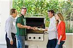Family Barbeque Stock Photo - Premium Rights-Managed, Artist: Kevin Dodge, Code: 700-03814698