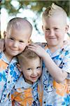 Three Boys in Hawaiian Shirts Stock Photo - Premium Royalty-Free, Artist: Mitch Tobias, Code: 600-03814728