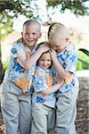 Three Boys in Hawaiian Shirts Stock Photo - Premium Royalty-Free, Artist: Mitch Tobias, Code: 600-03814729
