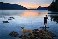 Teenager and Dog looking at Sunset, Fulford Harbour, Salt Spring Island, British Columbia, Canada Stock Photo - Premium Royalty-Freenull, Code: 600-03814746