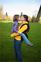 Mother and Daughter Kissing in Park Stock Photo - Premium Rights-Managednull, Code: 700-03814993