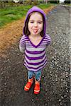 Girl Sticking Out Tongue Stock Photo - Premium Rights-Managed, Artist: Ty Milford, Code: 700-03815002