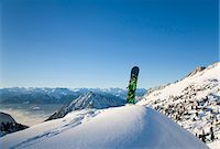 Snowboard in winter landscape Stock Photo - Premium Royalty-Freenull, Code: 649-03817439