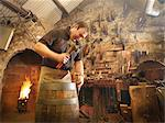 Worker making barrel in cooperage Stock Photo - Premium Royalty-Free, Artist: Robert Harding Images, Code: 649-03817836