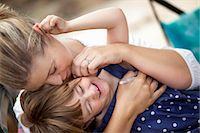 Mom hugging kid Stock Photo - Premium Royalty-Freenull, Code: 649-03818090