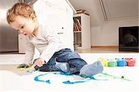 finger painting - Boy playing with finger paint Stock Photo - Premium Royalty-Freenull, Code: 649-03818287