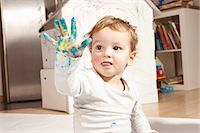 finger painting - Boys hand covered with finger paint Stock Photo - Premium Royalty-Freenull, Code: 649-03818288