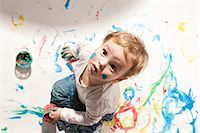 finger painting - Little boy playing with finger paint Stock Photo - Premium Royalty-Freenull, Code: 649-03818289