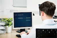Office worker using computer to perform job search Stock Photo - Premium Royalty-Freenull, Code: 614-03818869