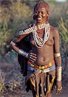 A Hamar girl in traditional attire.The Hamar are an attractive people with striking styles and clothes. Skins are widely used for clothing and cowrie shells are popular adornments yet the sea is 500 miles from their home. Stock Photo - Premium Rights-Managednull, Code: 862-03820464