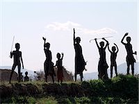 In the late afternoon, a group of Dassanech children wave to passing visitors along a bank of the Omo River in Southwest Ethiopia.The Dassanech speak a language of Eastern Cushitic origin.They live in the Omo Delta and they practice animal husbandry and fishing as well as agriculture. Stock Photo - Premium Rights-Managednull, Code: 862-03820478