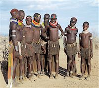 A group of Nyangatom girls and women with beautifully decorated leather skirts gather to dance.The Nyangatom are one of the largest tribes and arguably the most warlike people living along the Omo River in Southwest Ethiopia. Stock Photo - Premium Rights-Managednull, Code: 862-03820544