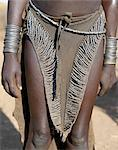 The leather skirt of a Nyangatom girl richly decorated with metal beads.The Nyangatom are one of the largest tribes and arguably the most warlike people living along the Omo River in Southwest Ethiopia. Stock Photo - Premium Rights-Managed, Artist: AWL Images, Code: 862-03820545