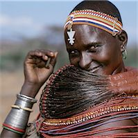 A Samburu woman wearing a mporro necklace, which denotes her married status. These necklaces were once made of hair from giraffe tails but nowadays, the fibres of doum palm fronds, Hyphaene coriacea, are used instead.The red beads after which the necklace is named are wound glass beads made in Venice c.1850. Stock Photo - Premium Rights-Managednull, Code: 862-03820644