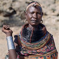 A Samburu woman wearing a mporro necklace, which denotes her married status. These necklaces were once made of hair from giraffe tails but nowadays, the fibres of doum palm fronds, Hyphaene coriacea, are used instead.The red beads after which the necklace is named are wound glass beads made in Venice c.1850. Stock Photo - Premium Rights-Managednull, Code: 862-03820646