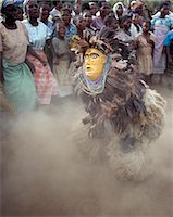 The Chewa people, Malawis largest ethnic group, live on the west side of Lake Malawi. Despite years of missionary influence, they still cling to old beliefs and rituals. For them, death simply means a journey of rebirth into the spirit world.The terrestrial representatives of this other world are grotesquely masked dancers known as Gule Wamkulu. Stock Photo - Premium Rights-Managednull, Code: 862-03820881