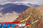 Ganden Monastery.Prayer flags mark the limit of pilgrims excursions into the hills around Ganden.They are usually strung around sacred places to purify the air and pacify the gods, and their fluttering is believed to release their written prayers into the heavens. The colours too are symbolic of the elements. Stock Photo - Premium Rights-Managed, Artist: AWL Images, Code: 862-03820988