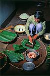 Making Sticky Rice cakes in preparation for Vietnamese New Year.Sticky rice cakes are a Vietnamese traditional dish that must be part of Tet meals.Every Vietnamese family must have sticky rice cakes among the offerings placed on the altar to their ancestors. Stock Photo - Premium Rights-Managed, Artist: AWL Images, Code: 862-03821051