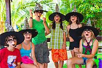 children in witch hats and masks Stock Photo - Premium Royalty-Freenull, Code: 673-03826277