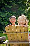 boy and girl looking over chair back Stock Photo - Premium Royalty-Free, Artist: J. A. Kraulis, Code: 673-03826365