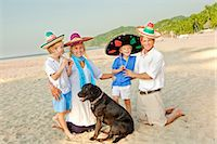 preteen  smile  one  alone - family on beach with dog Stock Photo - Premium Royalty-Freenull, Code: 673-03826423