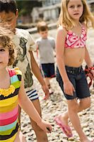 group of children walking on beach Stock Photo - Premium Royalty-Freenull, Code: 673-03826506