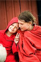 preteen girls bath - Two Scandinavian girls sitting with their towels wrapped around themselves, Oland, Sweden. Stock Photo - Premium Royalty-Freenull, Code: 6102-03826946