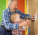A senior man doing carpentry with his grandchild, Sweden. Stock Photo - Premium Royalty-Free, Artist: AWL Images, Code: 6102-03826957