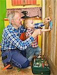 A senior man doing carpentry with his grandchild, Sweden. Stock Photo - Premium Royalty-Free, Artist: Ikon Images, Code: 6102-03826958