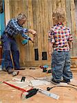 A senior man doing carpentry with his grandchild, Sweden. Stock Photo - Premium Royalty-Free, Artist: AWL Images, Code: 6102-03826963