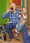 A senior man with his grandchild, Sweden. Stock Photo - Premium Royalty-Free, Artist: Ikon Images, Code: 6102-03826964