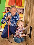 A senior man doing carpentry with his grandchild, Sweden. Stock Photo - Premium Royalty-Free, Artist: AWL Images, Code: 6102-03826965