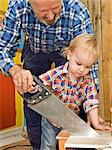 A senior man doing carpentry with his grandchild, Sweden. Stock Photo - Premium Royalty-Free, Artist: Ikon Images, Code: 6102-03826966