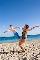 Mother and child playing on the beach. Stock Photo - Premium Royalty-Freenull, Code: 6102-03827214