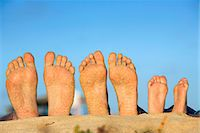 Feet in the sand on a beach. Stock Photo - Premium Royalty-Freenull, Code: 6102-03827218