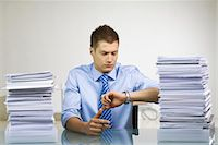 A man with a pile of paper. Stock Photo - Premium Royalty-Freenull, Code: 6102-03827255