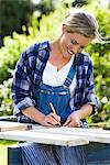 A woman doing carpentry in a garden, Sweden. Stock Photo - Premium Royalty-Free, Artist: AWL Images, Code: 6102-03828150