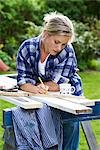 A woman doing carpentry in a garden, Sweden. Stock Photo - Premium Royalty-Free, Artist: AWL Images, Code: 6102-03828159