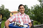 A man recycling aluminium cans, Sweden. Stock Photo - Premium Royalty-Free, Artist: Arcaid, Code: 6102-03828449